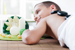 Young boy relaxing in spa salon Stock Photography