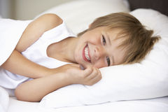 Young Boy Resting In Bed Royalty Free Stock Photos