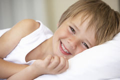 Young Boy Resting In Bed Royalty Free Stock Images