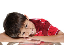 Young boy resting head in arms Stock Photo