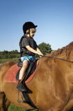 Young boy ride a horse Stock Images