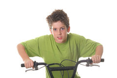 Young boy riding bicycle fast. Isolated on white Royalty Free Stock Image