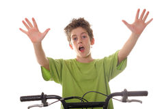 Young boy riding bicycle with hands up stock photography