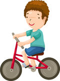 Young boy riding a bicycle Stock Images