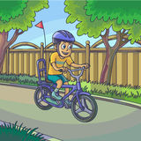 Young boy riding a bicycle on street. Royalty Free Stock Image