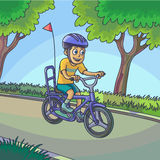 Young boy riding a bicycle on street. Stock Photo