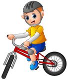 Young boy riding a bicycle on a white background. Illustration of Young boy riding a bicycle on a white background Royalty Free Stock Image