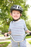 Young boy riding a bike Stock Photos