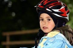 Young boy riding a bike Stock Photos