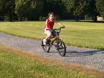 Young boy riding a bike Stock Image