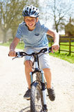 Young Boy Riding Bike Along Country Track Royalty Free Stock Images