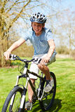 Young Boy Riding Bike Along Country Track Royalty Free Stock Image