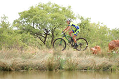 Young boy riding on edge of dam at Mountain Bike Race Royalty Free Stock Image