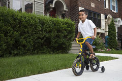 Young boy riding his bicycle Stock Photo
