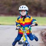 Young boy riding his bike Stock Photos