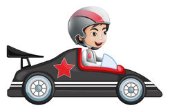 A young boy riding in his racing car Stock Images
