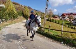 Young boy riding a horse Stock Photo