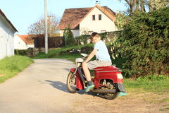 Young boy riding a motorbike Royalty Free Stock Photos