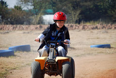 Young Boy riding a Quadbike Stock Photo