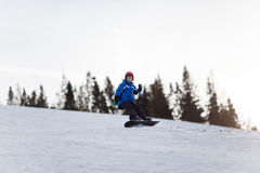 Young boy riding snowboard Royalty Free Stock Images