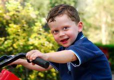 Free Young Boy Riding Toy Motorcycle Stock Image - 4863101