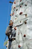Young Boy Rock Climbing Stock Images