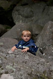 Young boy rock climbing Stock Photos