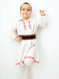 Young boy dancing in romanian traditional clothes Royalty Free Stock Photo