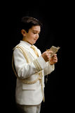 Young boy with rosary and prayer book. A young boy with rosary and prayer book celebrating his First Holy Communion Royalty Free Stock Photography