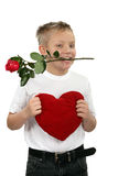 Young boy with a rose in his mouth Stock Photos