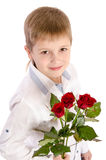 Young boy with roses Royalty Free Stock Image