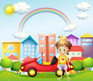 A young boy with a rubber duck and his car in front of the high Royalty Free Stock Photos