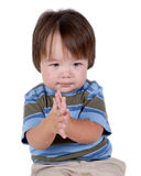 Young boy rubbing hands Stock Photo
