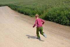 Young boy run in the fields Royalty Free Stock Photography