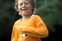Young boy running. Cute blond young boy running (motionblur due to running Stock Photos