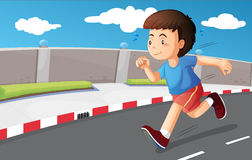 A young boy running at the street Royalty Free Stock Photos