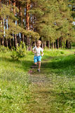 A young boy runs Stock Photography