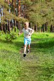 A young boy runs Royalty Free Stock Images