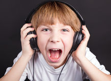 Young boy's singing. With headphones Royalty Free Stock Image
