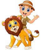 Young boy in safari suit and wild lion cartoon Stock Photos