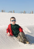 Young boy on sand dune Stock Photo