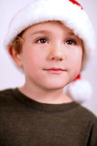 Young boy in a santa hat. Isolated on white Royalty Free Stock Photography