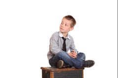 Young boy sat cross-legged Stock Photography