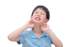 Young boy scratching his face Stock Photography