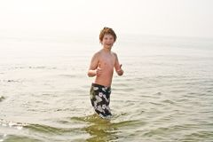 Young boy in the sea in cold water Royalty Free Stock Image