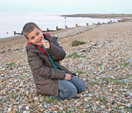 Young boy searching for seashells Royalty Free Stock Photos