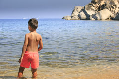 Young boy seeing the sea Stock Images