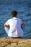 Young boy seeing the sea Stock Photography