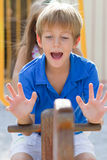 Young boy on the seesaw Royalty Free Stock Photography
