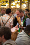 Young boy selling bretzels. At Oktoberfest Royalty Free Stock Images